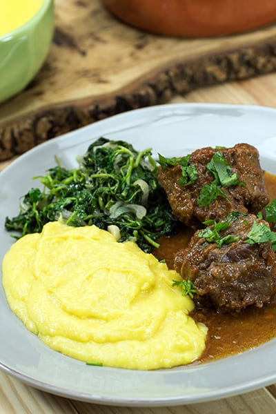 Oxtail with polenta and cress